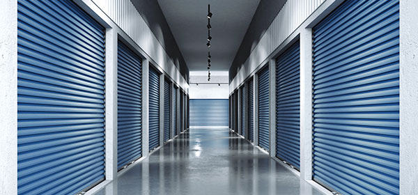 interior of self storage hallway with blue doors