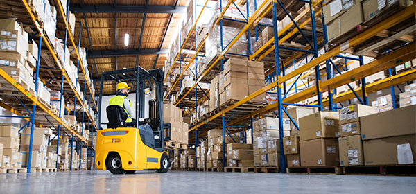 Warehouse aisle with fork lift