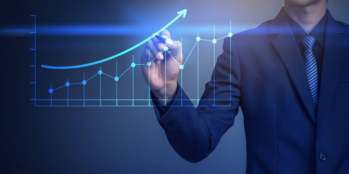 Man in suit with graph showing loan interest rates