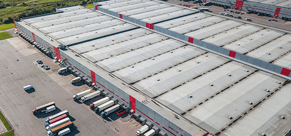 Aerial view of warehouse with semi trucks