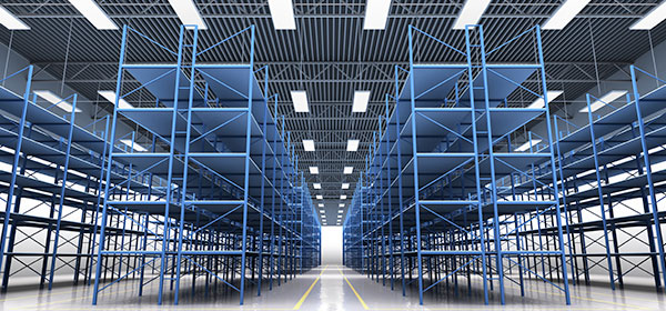 Empty warehouse with blue shelving