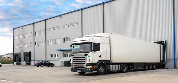 Warehouse exterior with truck docked