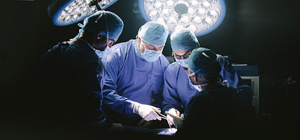 Group of surgeons at operating table